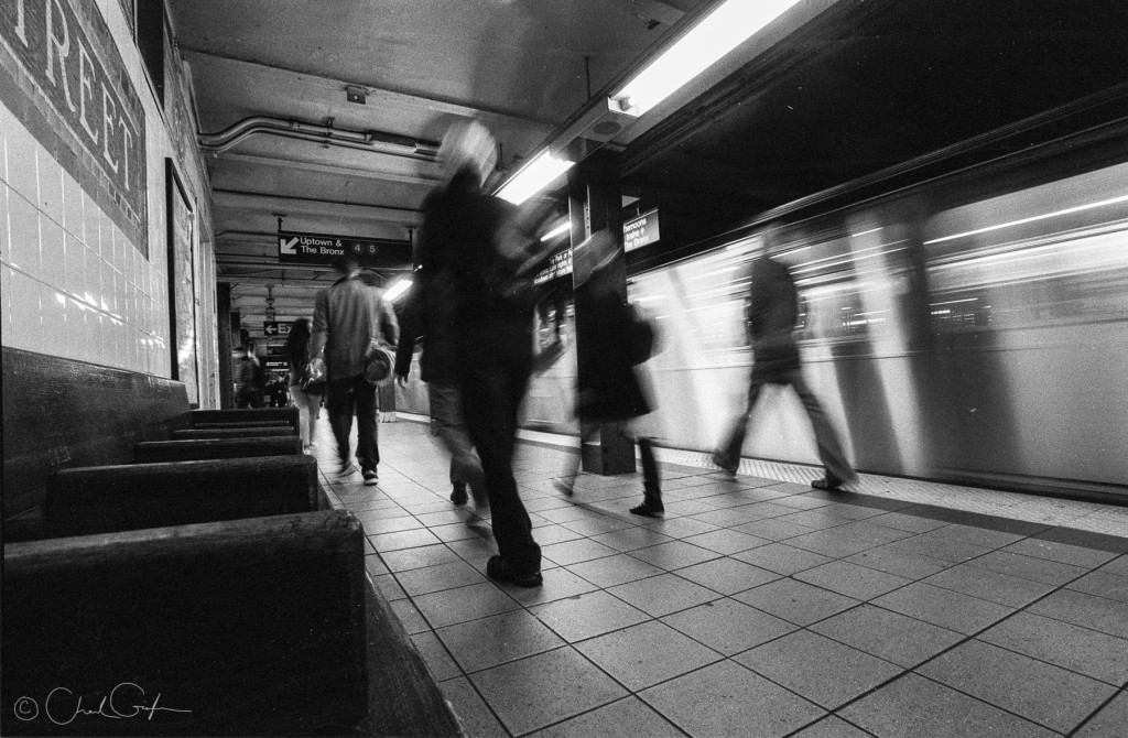 Figures in a Train Station, Black and White Image by Chad Gayle