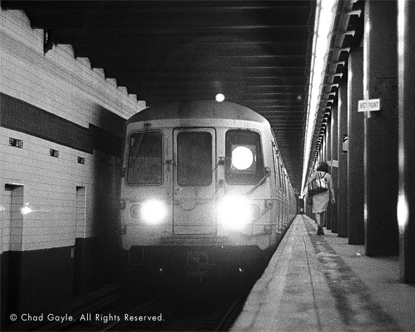Woman boarding the subway at 2nd Avenue