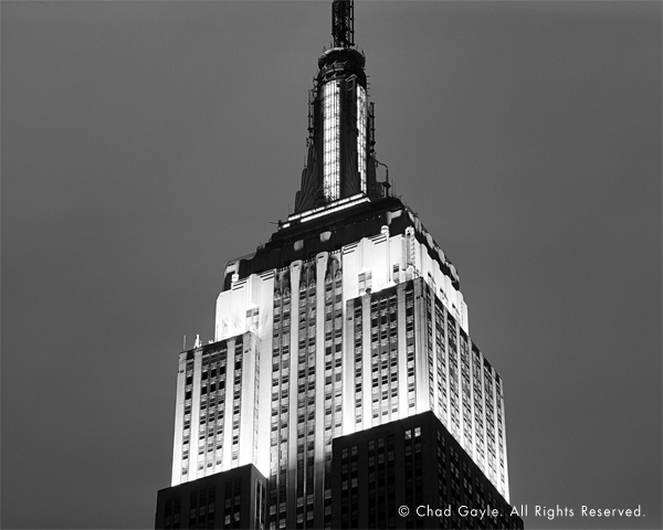 A close-up of the Empire State Building at night