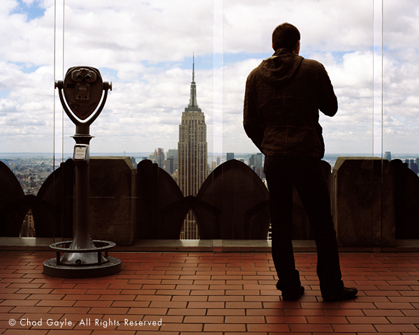 A tourist at Rockefeller Center's Top of the Rock